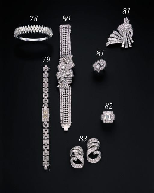 A DIAMOND CLIP BROOCH AND A DIAMOND RING