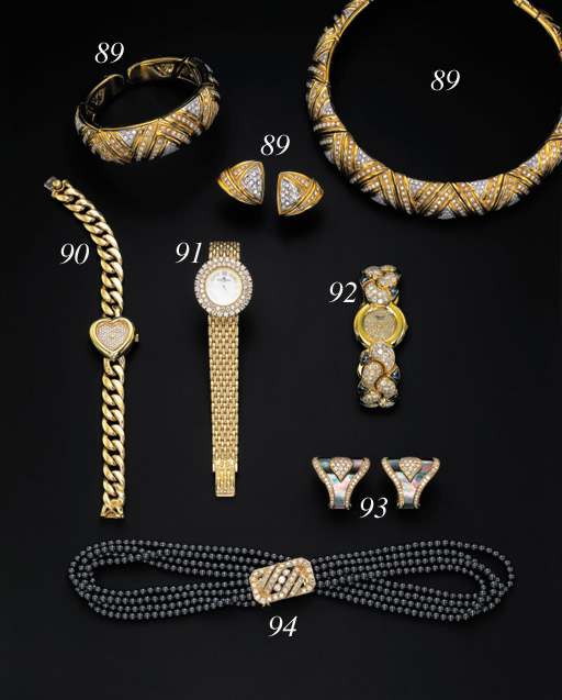 A DIAMOND AND 18K GOLD WRISTWATCH, BY BAUME & MERCIER