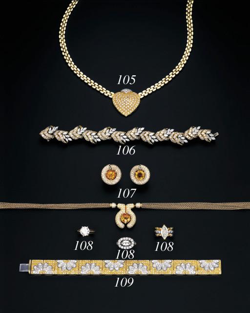 A DIAMOND AND YELLOW DIAMOND BRACELET