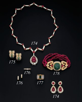 A CARVED EMERALD, RUBY BEAD AN