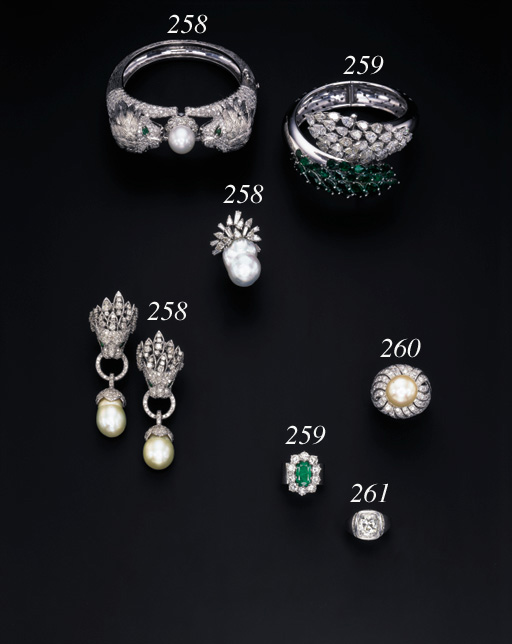 AN EMERALD AND DIAMOND BANGLE AND AN EMERALD AND DIAMOND CLUSTER RING