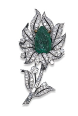 A DIAMOND AND CARVED EMERALD F