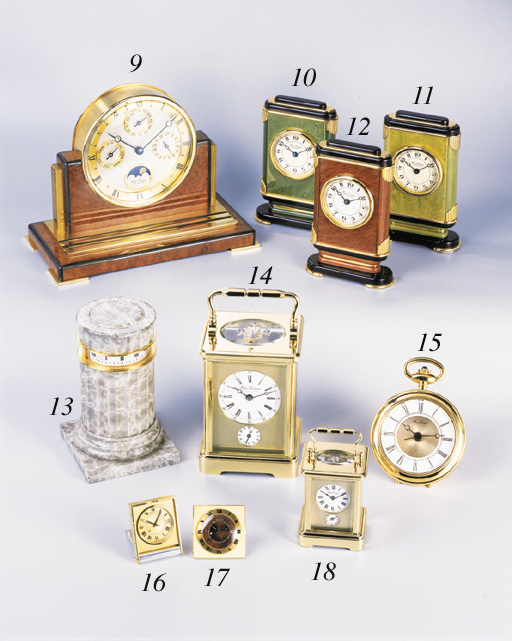 Hour Lavigne. A gilt and marble table clock