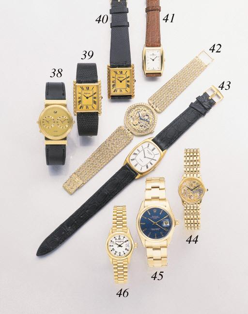 DeLaneau. An 18K gold rectangular wristwatch