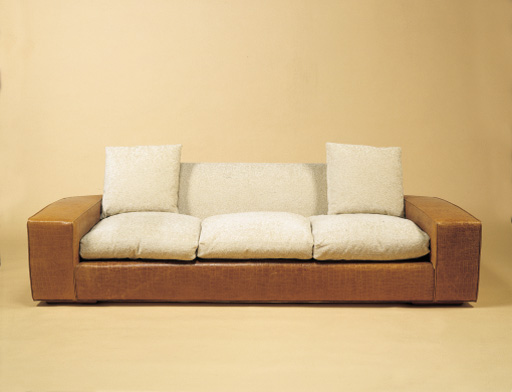 AN EMBOSSED LEATHER AND CHENILLE-UPHOLSTERED CUSTOM \'\'SPEED\'\' SOFA ...