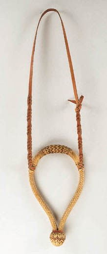 A THREE COLOR RAWHIDE BOSAL BY