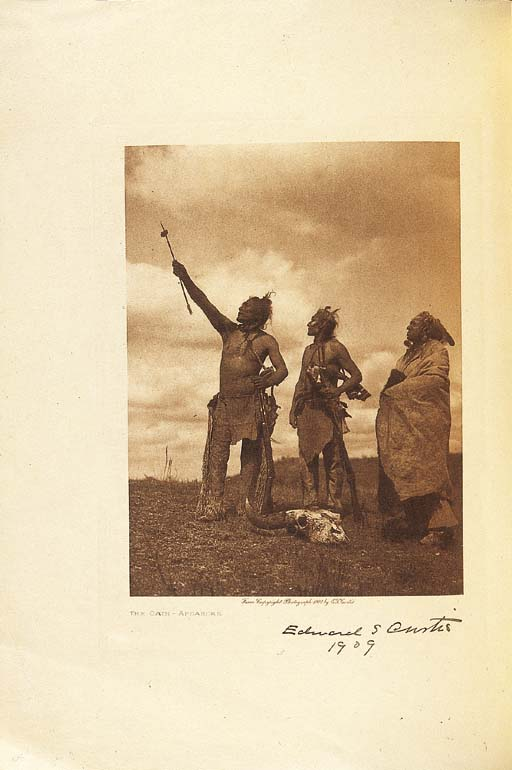 """CURTIS, Edward S. [Prospectus] The North American Indian, being a Series of Volumes Picturing and Describing the Indians of the United States and Alaska. [New York], 1907. 4o. Two photogravures: """"The Oath -- Apsaroke"""" and """"Navaho Medicine-Man."""" Original printed wrappers. SCARCE ORIGINAL PROSPECTUS OF CURTIS' MONUMENTAL NORTH AMERICAN INDIAN, SIGNED BY CURTIS ON THE FRONTISPIECE AND DATED 1909. Of this original prospectus, presumably no more than 500 copies were printed. Signed copies are very rare on the market, with none recorded in ABPC since 1975."""