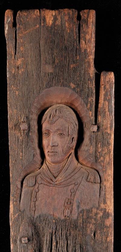 A Wood Carving Of Oliver Hazar