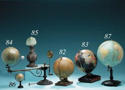 A cast bronze memorial globe t