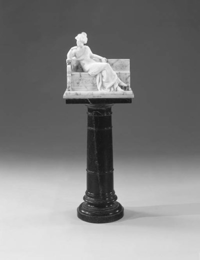 A VEINED WHITE MARBLE FIGURE O