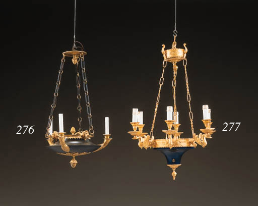 AN EMPIRE STYLE ORMOLU AND PATINATED-BRONZE THREE-LIGHT CHANDELIER