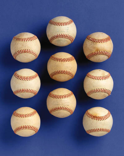 A GROUP OF NINE GAME USED BASE