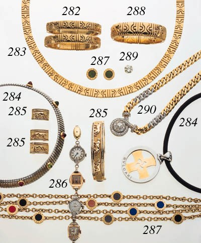 SUITE OF YELLOW GOLD AND GEMSE
