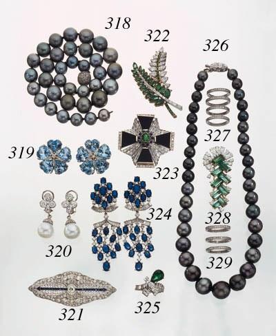 AN EMERALD AND DIAMOND FOLIATE