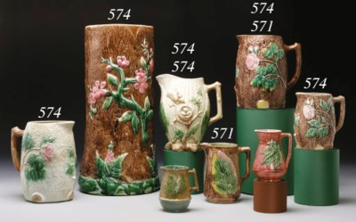 FIVE MAJOLICA PITCHERS AND A C