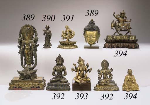 A TIBETAN GILT BRONZE BUDDHIST
