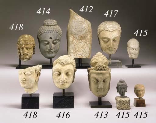 A GREY SCHIST HEAD OF BUDDHA