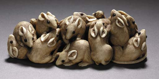 AN IVORY FIGURAL GROUP OF MICE