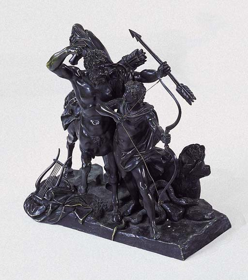 A BRONZE EQUESTRIAN GROUP OF A