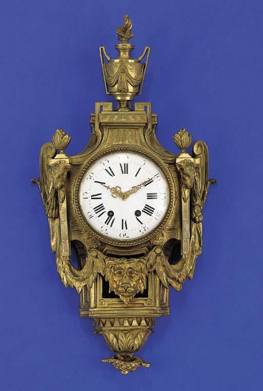 A LOUIS XVI STYLE ORMOLU CARTE