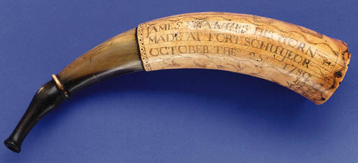 A CARVED POWDER HORN, DATED 17