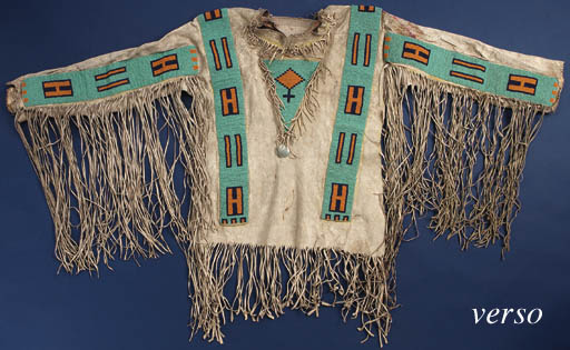 A BLACKFOOT BEADED AND FRINGED HIDE CEREMONIAL SHIRT