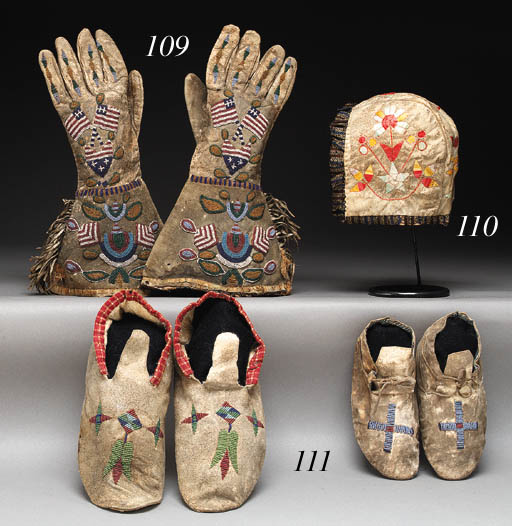 A PAIR OF SANTEE SIOUX BEADED AND FRINGED HIDE GAUNTLETS