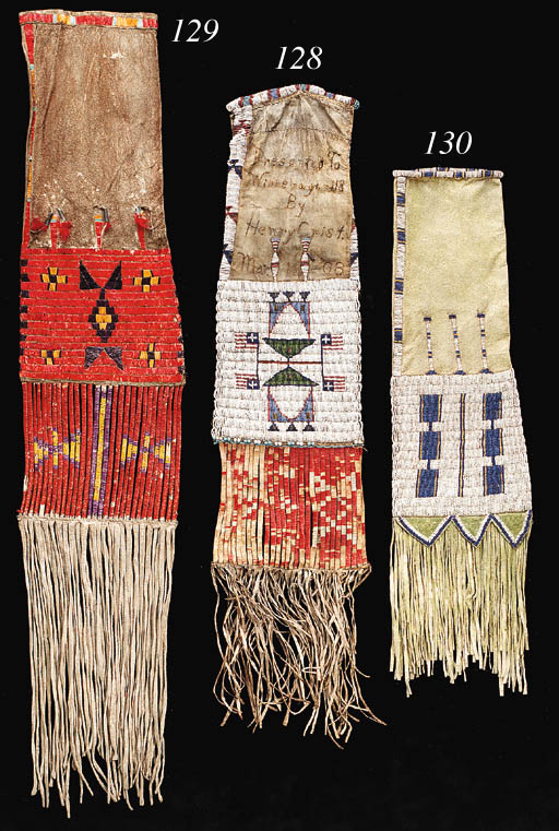 AN UTE BEADED AND FRINGED HIDE