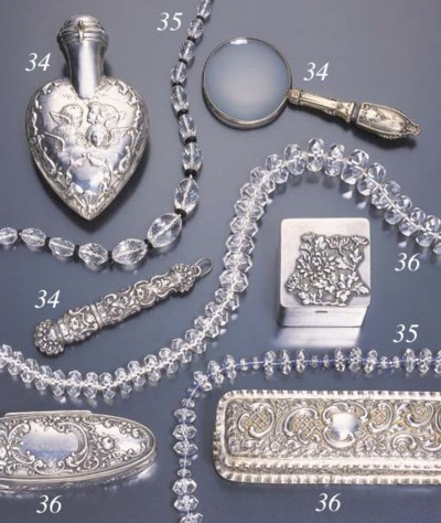 A GROUP OF ASSORTED SILVER ACC