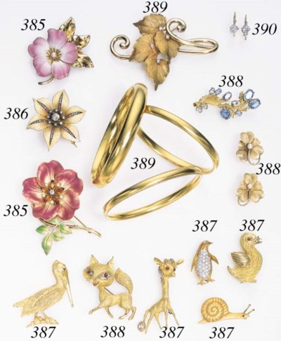 A SET OF GOLD AND ENAMEL FLOWE