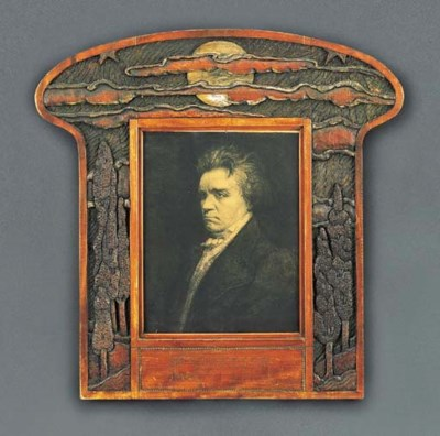 A CARVED WOOD FRAME