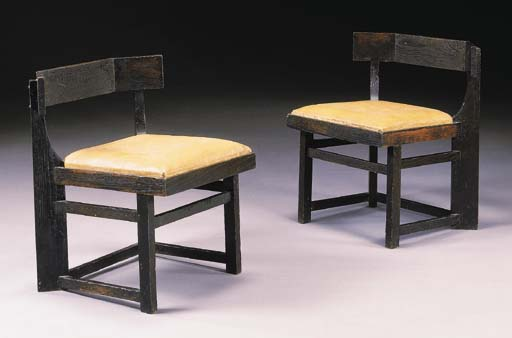 A PAIR OF EBONIZED OAK CHAIRS
