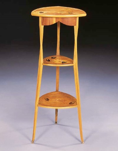 A MARQUETRY THREE-TIERED SELLE