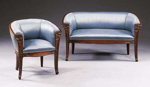 A CARVED MAHOGANY SETTEE AND A