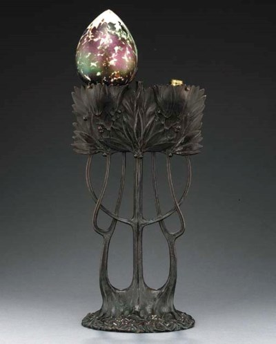 A BRONZE AND GLASS TABLE LAMP