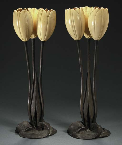 A PAIR OF BRONZE AND ALABASTER