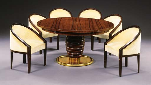 A ROSEWOOD TABLE AND SIX CHAIR