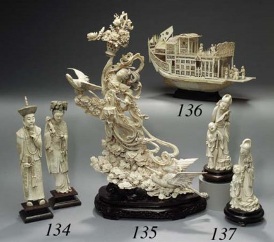 A PAIR OF IVORY FIGURAL FORM V