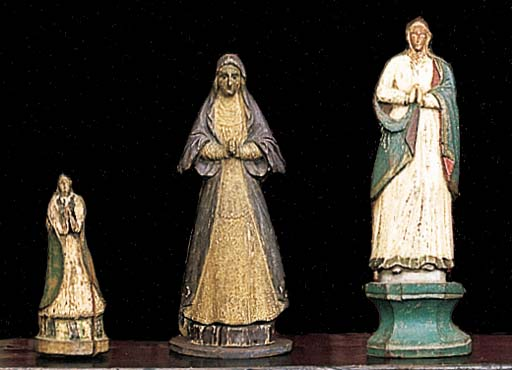 A GROUP OF FOUR SPANISH CARVED