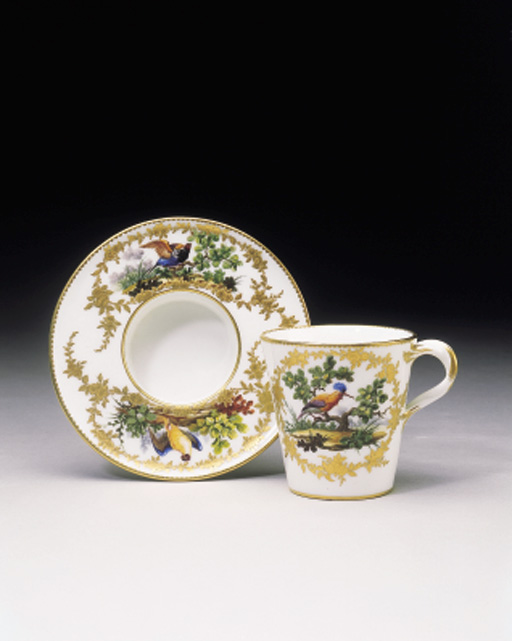 A SEVRES CUP AND SOCKETED SAUC