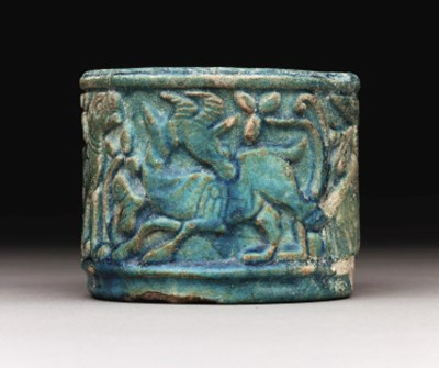 A FAIENCE CYLINDRICAL VESSEL