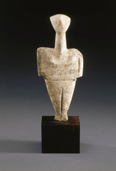 A CYCLADIC MARBLE FEMALE FIGUR