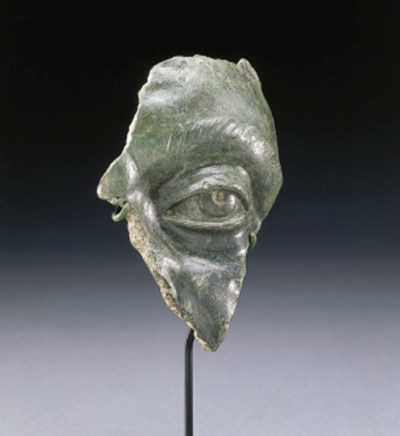 A ROMAN BRONZE FRAGMENT FROM A