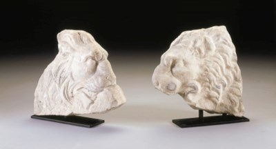 A PAIR OF ROMAN MARBLE LION PR