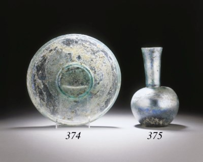 A ROMAN GLASS FOOTED PLATE