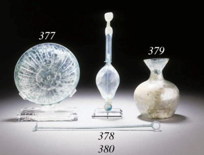 A ROMAN GLASS RIBBED BOWL