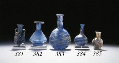 A ROMAN FACETED GLASS BOTTLE