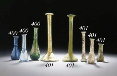 FIVE ROMAN GLASS UNGUENTARIA