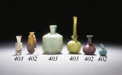 FOUR ROMAN GLASS OBJECTS
