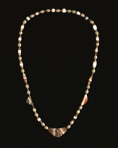 AN ACHAEMENID BANDED AGATE AND